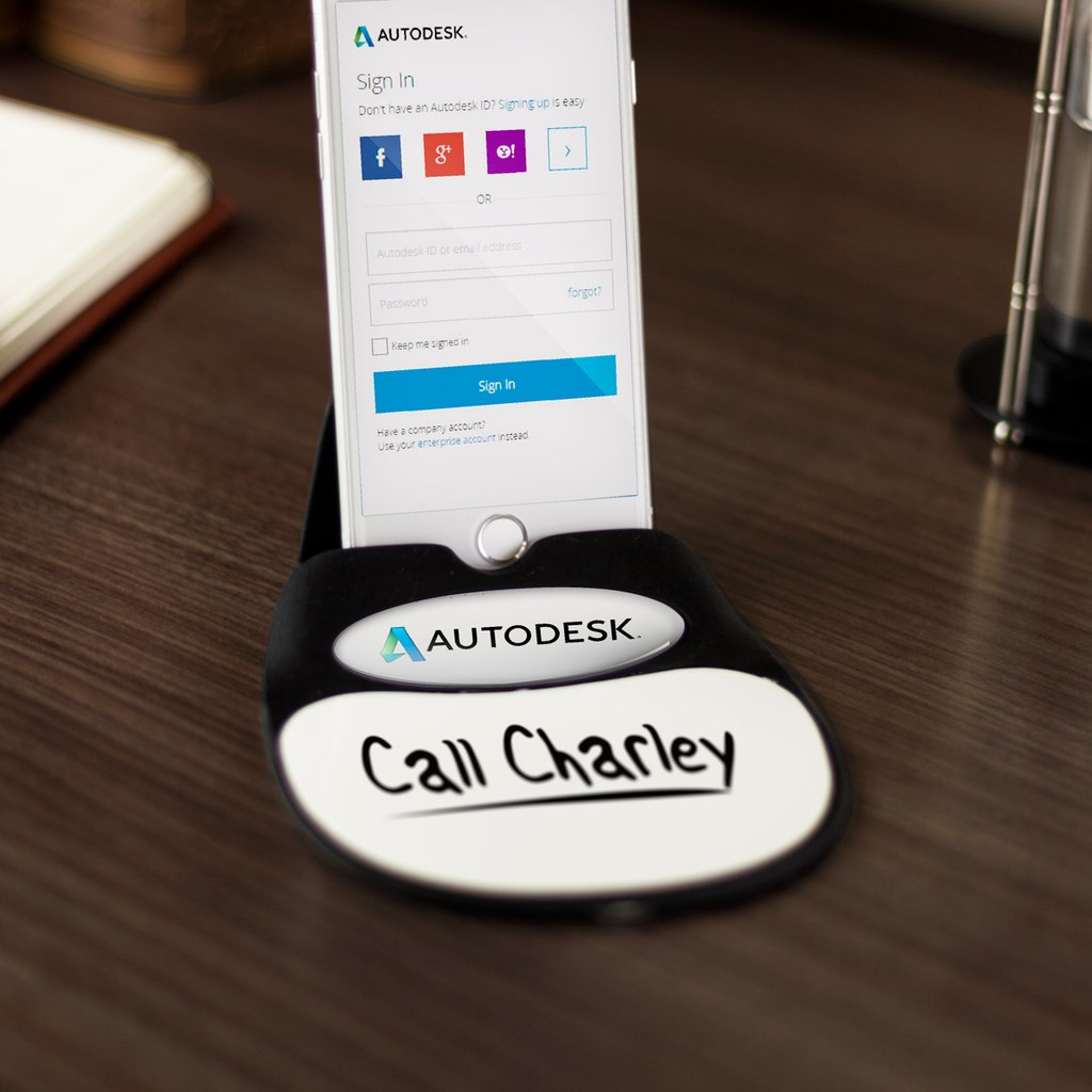 A picture of a branded tiny white board desk attachment with a phone stand