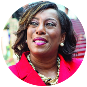 Headshot of Adrienne Trimble, President and CEO of NMSDC, who provides a quote about the benefits of working with MBE certified companies.
