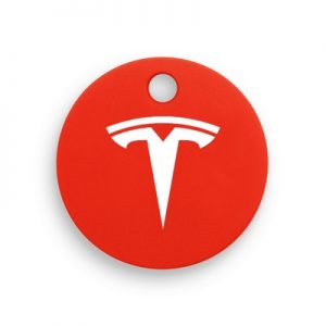 A picture of a red Chipolo with a Tesla logo printed in white on the front